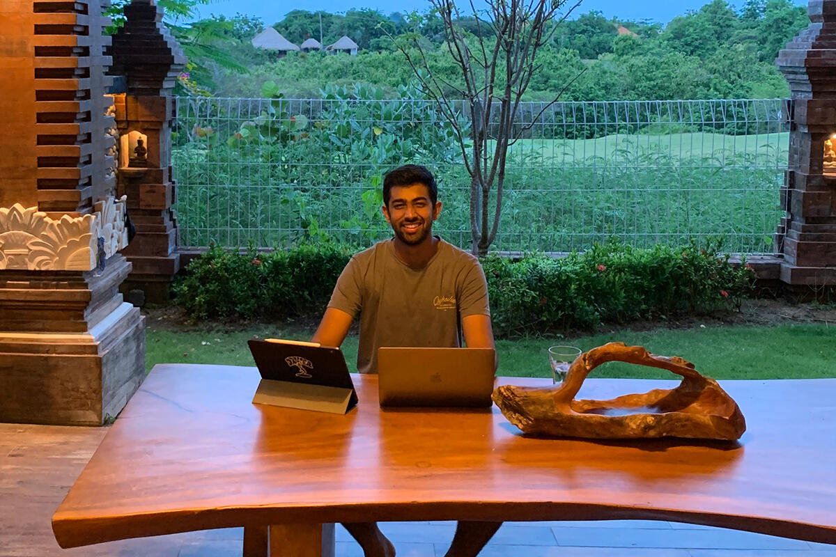 Pranav Daryanani attending remote classes from an open-air space in Bali, Indonesia