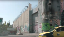 Wall with graffiti and barbed wire