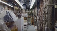 Back room of Peabody museum, dense with materials on shelves